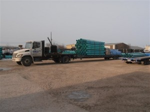 Emco truck loaded with HDPE pipe